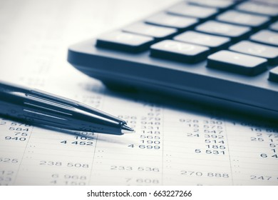 Financial accounting. Pen and calculator on report