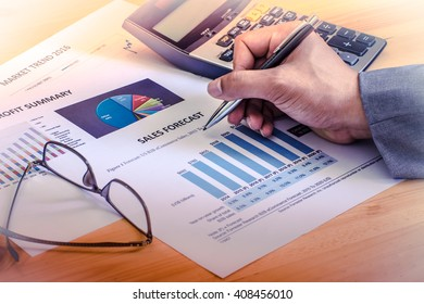 Financial accounting sales forecast graphs analysis with hand writing , digital effect abstract for background