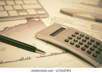 Financial accounting stock market graphs and charts analysis Calculator and computer keyboard