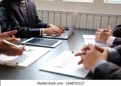 financial adviser discussing with investor. business people have a meeting. businessman working on startup project with co-worker team. - Shutterstock ID 1668715117