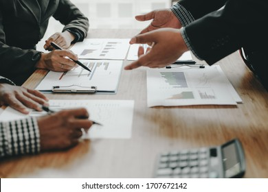 financial adviser discussing with investor. business people have a meeting. businessman working on startup project with co-worker team.