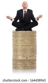 Financial Adviser sat on a stack of money