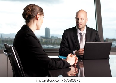 Financial adviser talking with a client in bank building