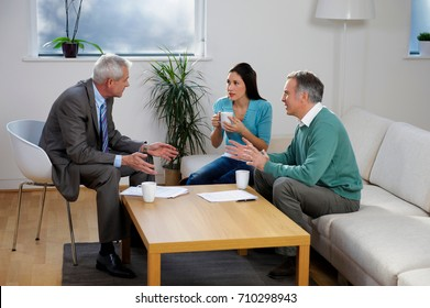 Financial adviser talking to couple