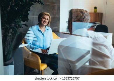 financial advisor with client in office