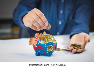 financial advisor puts small coins into a beautiful treasure chest. High interest. Money taken from the client at the full annual rate.