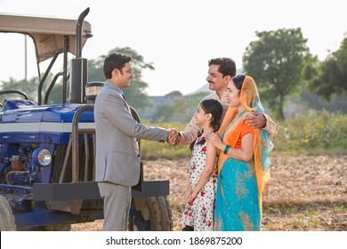 Financial advisor shaking hands with a farmer