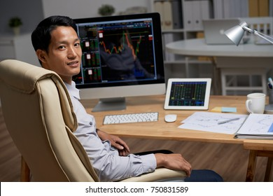 Financial analyst working with data from stock market