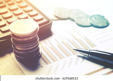 Financial analyzing concept, Pen and calculator with thailand coin on paperwork