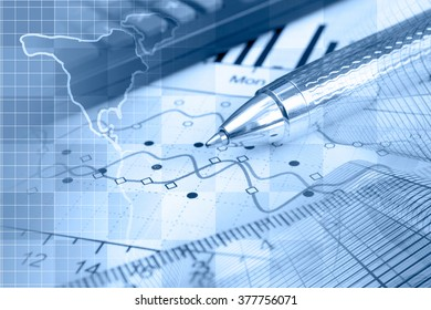Financial background in blues with map, buildings, calculator, table and pen.