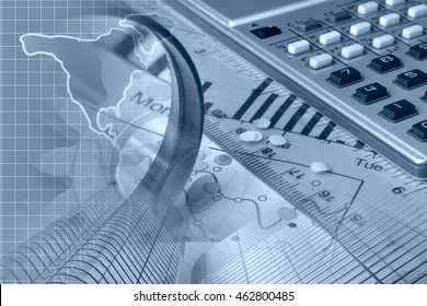 Financial background in blues with map, calculator, graph and buildings.