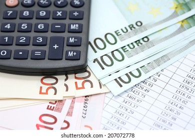 Financial background. European Union Currency near calculator on paper background with digits table