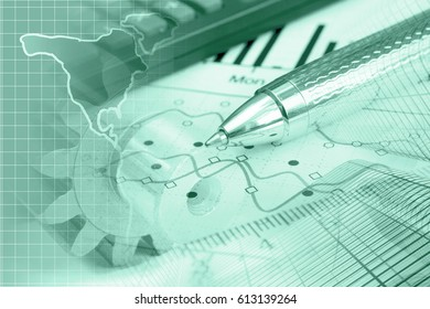 Financial background in greens with map, calculator, graph and pen.