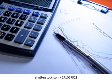 Financial background with money, calculator, graph and pen