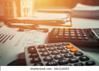 Financial and banking documents with calculator, vintage office.