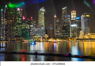 Financial and business buildings at Marina Bay with music and light show on foreground