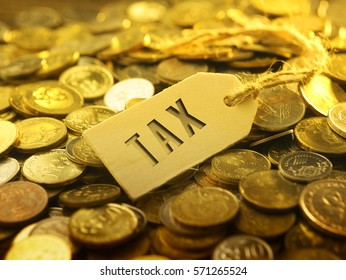 financial or business concept ,coin with tag tax