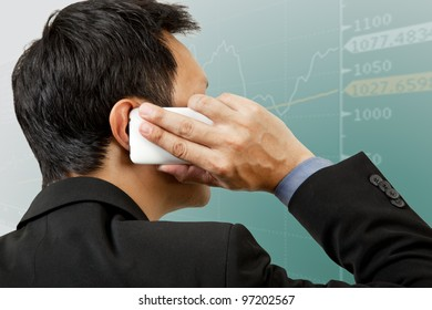 Financial businessman on phone reporting