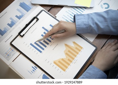 Financial businessmen analyze the graph of the company's performance to create profits and growth, Market research reports and income statistics, Financial and Accounting concept.