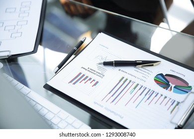 financial chart and pens on the table from a businessman.