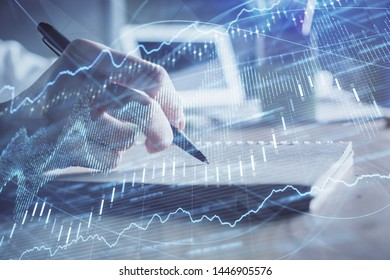 Financial charts displayed on woman's hand taking notes background. Concept of research. Double exposure
