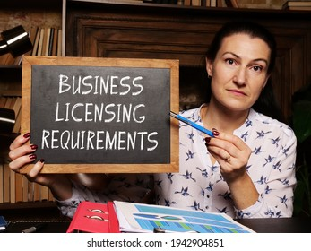 Financial concept about BUSINESS LICENSING REQUIREMENTS with inscription on the chalkboard