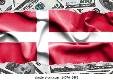 Financial concept with banknotes of US currency around national flag of Denmark