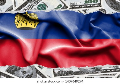 Financial concept with banknotes of US currency around national flag of Lichtenstein