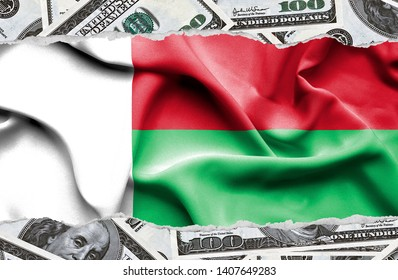 Financial concept with banknotes of US currency around national flag of Madagascar