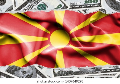 Financial concept with banknotes of US currency around national flag of Macedonia