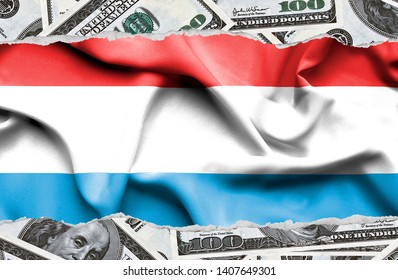 Financial concept with banknotes of US currency around national flag of Luxembourg