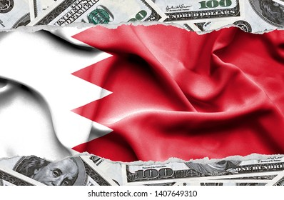 Financial concept with banknotes of US currency around national flag of Bahrain
