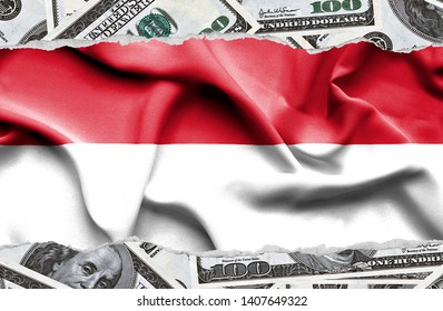 Financial concept with banknotes of US currency around national flag of Monaco