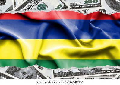 Financial concept with banknotes of US currency around national flag of Mauritius