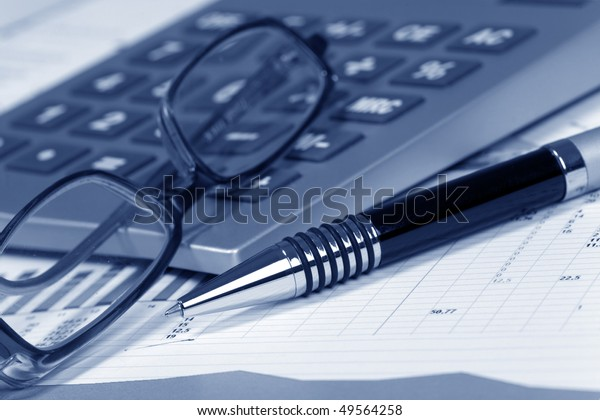 Financial concept. Calculator and pen.