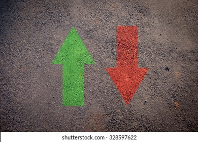 Financial concept. Up and Down Arrows on the grunge road texture, indicated stock market activity.