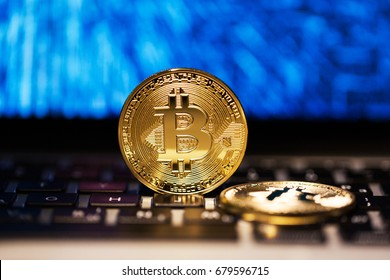 Financial concept of emission golden bitcoin on electronic scheme background
