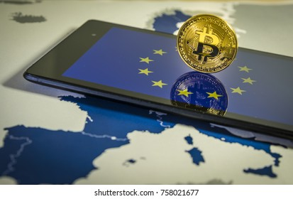 Financial concept with golden Bitcoin over smartphone, UE flag and map. Situation of Bitcoin and other cryptocurrencies in European Union concept.