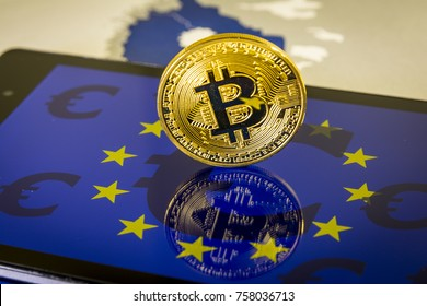 Financial concept with golden Bitcoin over smartphone, with EU flag and euro symbol. Situation of Bitcoin and other cryptocurrencies in European Union concept.