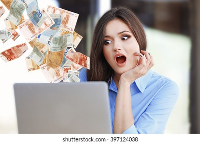 Financial concept. Make money on the Internet. Young woman working with laptop in the office