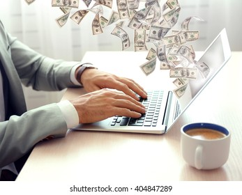 Financial concept. Make money on the Internet. Man working with laptop in office