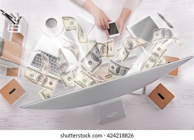 Financial concept. Make money on the Internet. Businesswoman works at office.