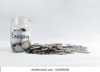 Financial concept, A malaysia ringgit coin in transparent glass bottle isolated white background with word label Emergency