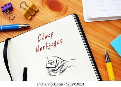 Financial concept meaning Cheap Mortgages with phrase on the piece of paper.