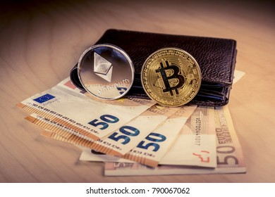 Financial concept with physical bitcoin and ethereum over a leather wallet with Euro bills inside