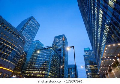 Financial Corporate Skyscraper office building at night in Canary Wharf, London City, England, UK
