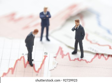 Financial crisis. Figures of businessman on financial charts