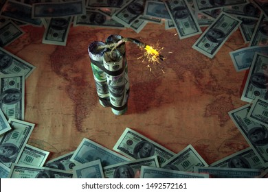 Financial crisis.The world of money is burning.Financial bomb explodes.Smoke,fuse.Dollar and Euro decrease. Global economic recession concept.World map in the background.