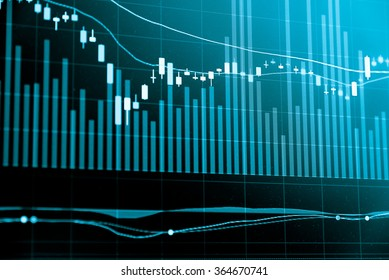 Financial data on a monitor. Business statistics and analytics, glowing sheet beznes statistics of exchange trading in the dark.