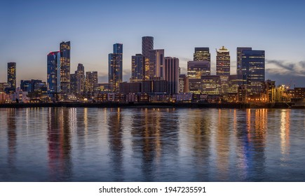 The financial district of London, Canary Wharf, with the illuminated, cooperate skysrcapers during evening time